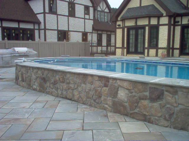 Semi Inground Pool With Unique Stone Facade Longislandswim