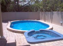 Spillover Spa attached to Semi Inground Pool
